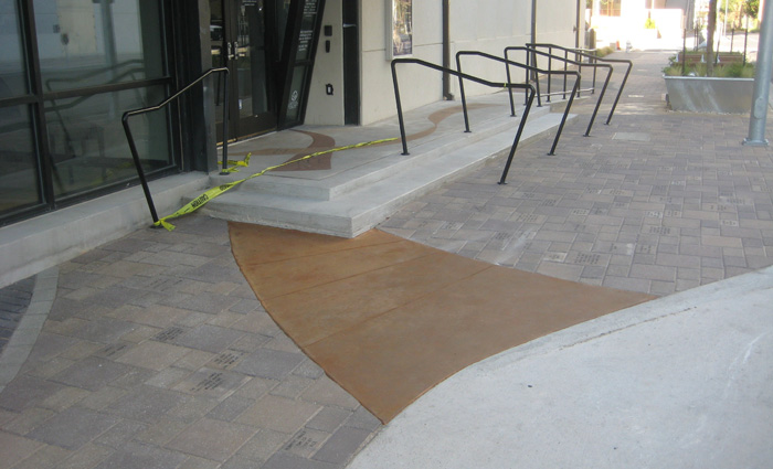 New ramp with stained concrete ribbons and handrails